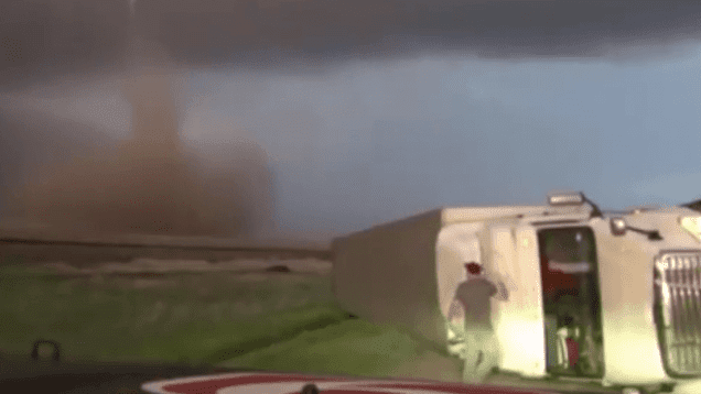 Kansas Storm Trackers Capture Incredible Video of Tornado and Big Rig